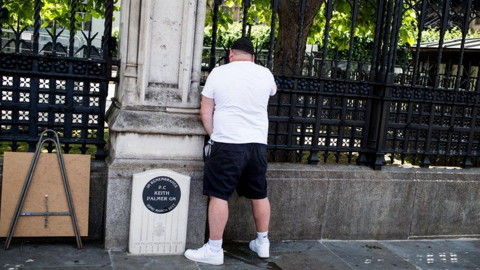 A man appearing to urinate on PC Keith Palmer's memorial
