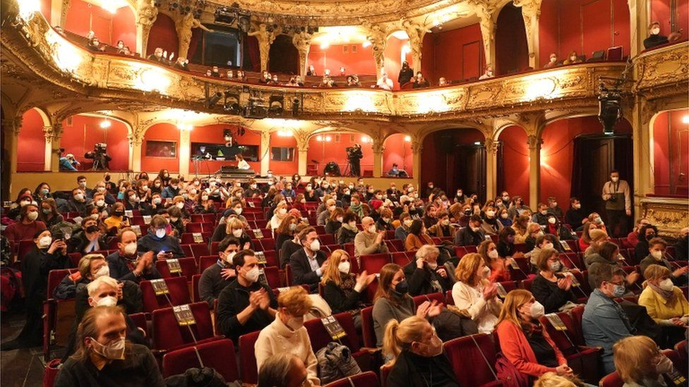 Members of the audience wear protective masks and sit spaced apart at the first in-person performance at the Berliner Ensemble theatre in 2021 during the coronavirus (Covid-19) pandemic, in Berlin, Germany, 19 March 2021