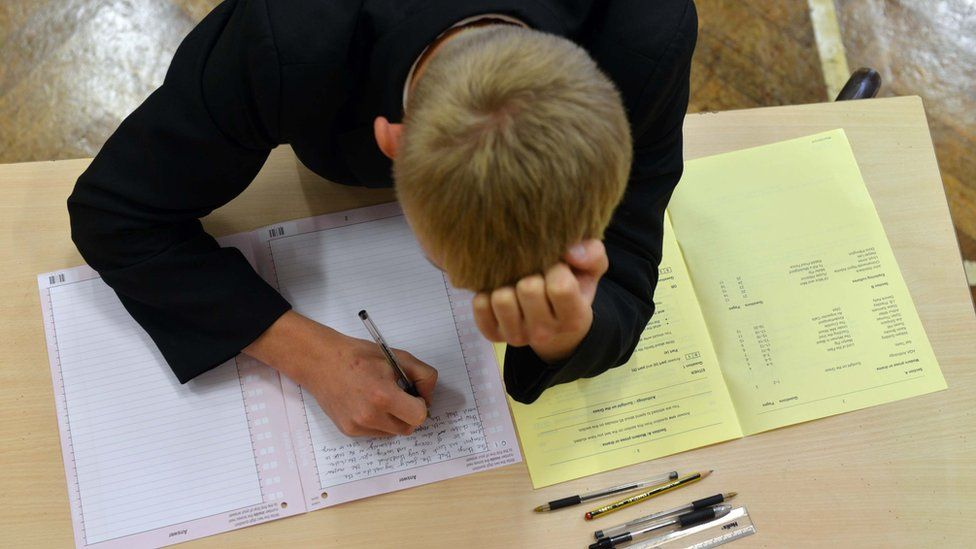 Schoolboy taking GCSE examination