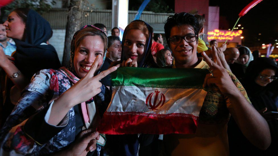 Iranians take to the streets to celebrate after Iran's nuclear negotiating team struck a deal with world powers in Vienna.