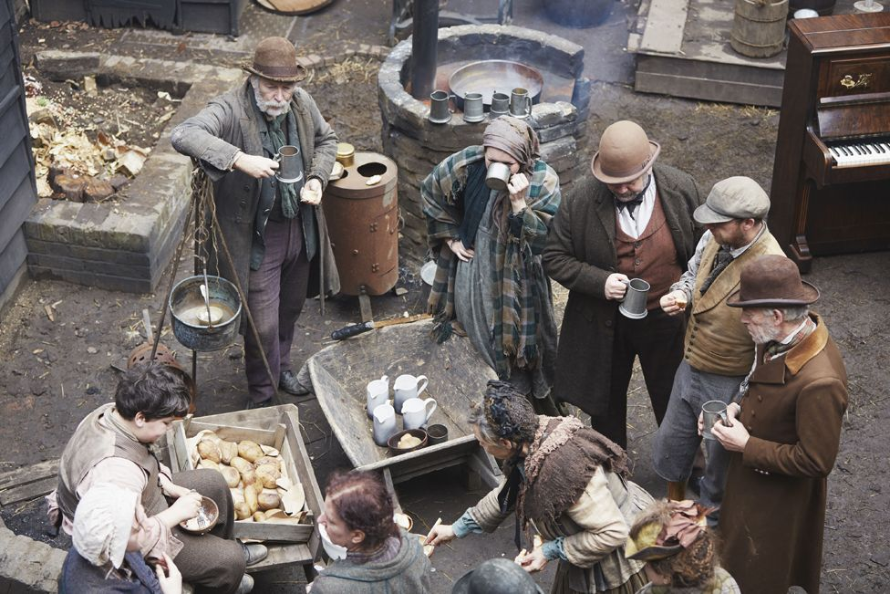 People dressed as Victorians taking part in The Victorian Slum