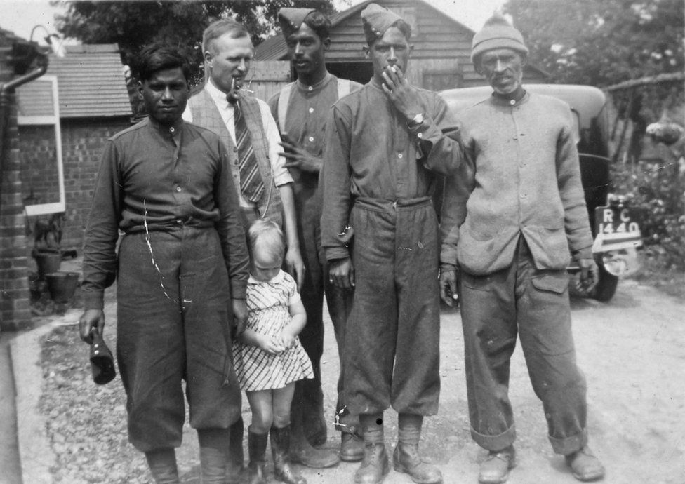 Kundan Lall, Herbert Foster, Betty Foster and three unidentified sepoys at the Fosters' house near Shirley, autumn