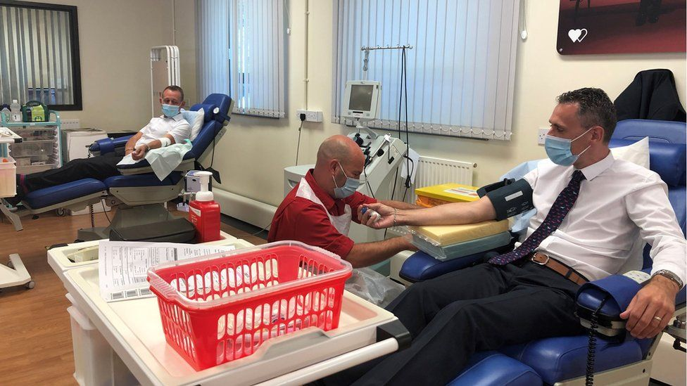 Martin and Carl giving blood