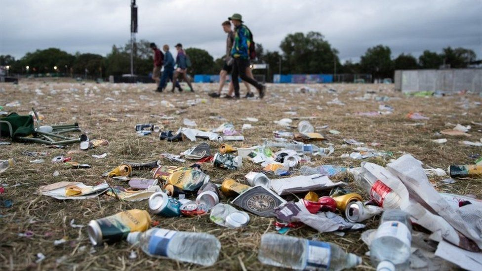 Discarded plastic bottles been left behind by festival-goers