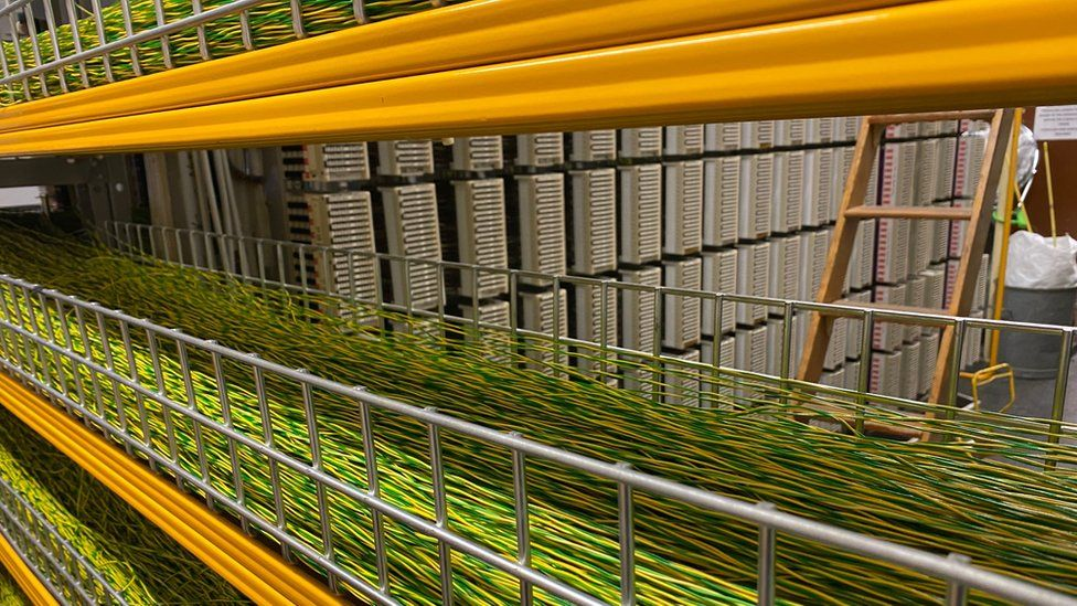 Strings of copper cable are laid out on racks