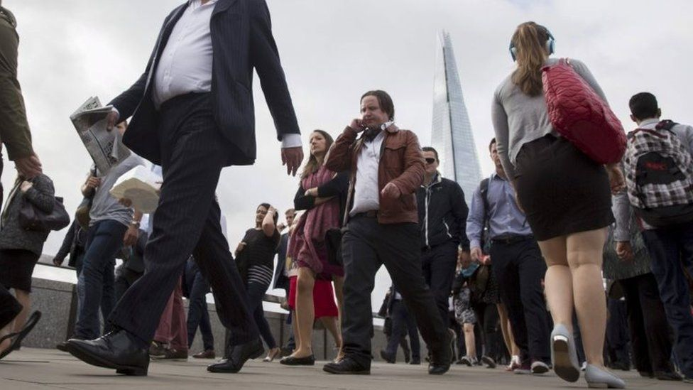 Commuters cross London Bridge in London, in this August 6, 2015 file picture.