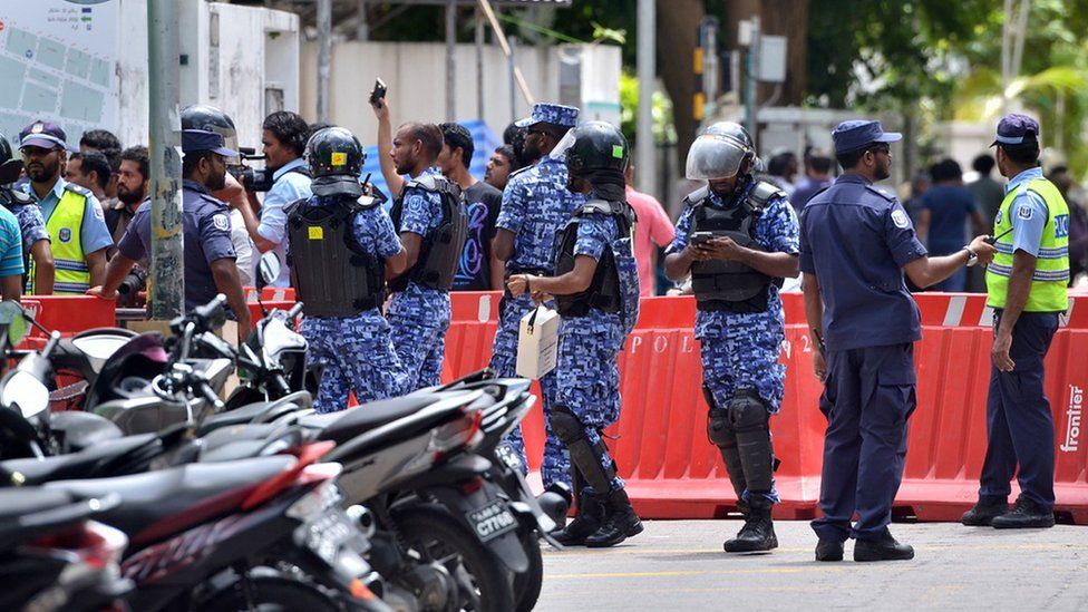 Maldives police patrol the streets of the capital Male.