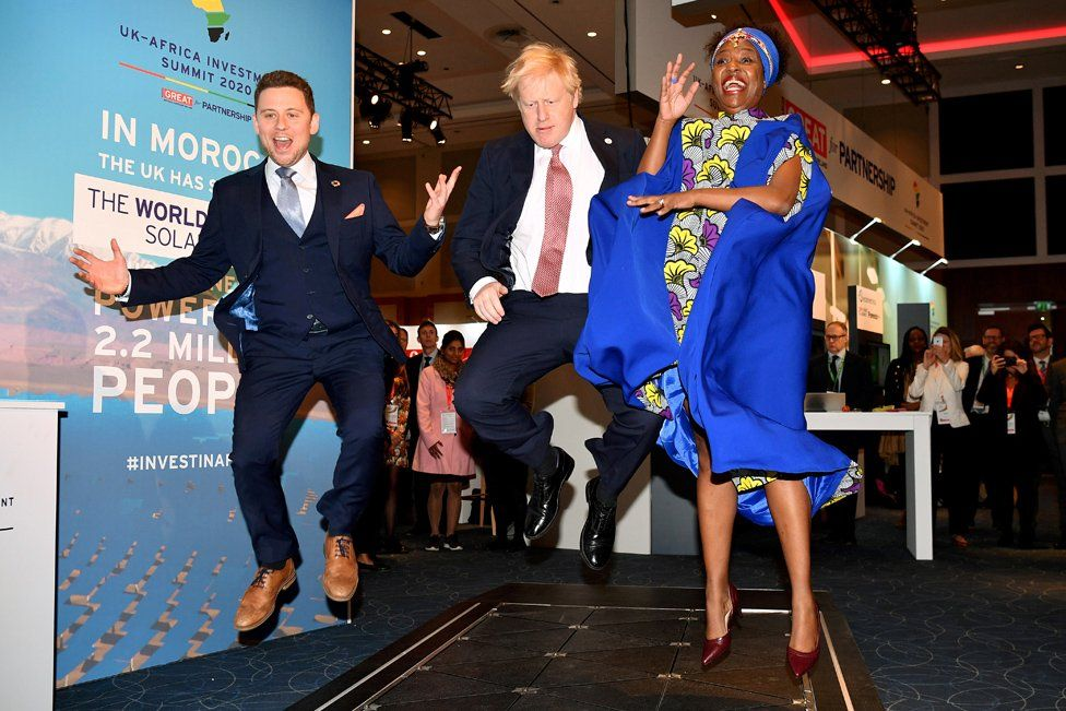 Prime Minister Boris Johnson visits the stand of a company that converts footsteps into energy, at the Innovation Zone during the UK-Africa Investment Summit in London