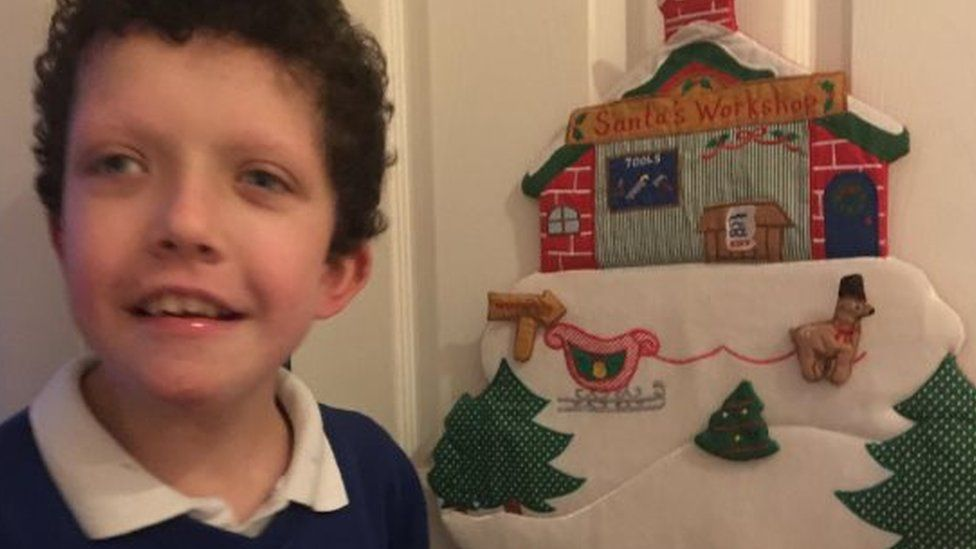 Marshall with his snow-scene to decorate