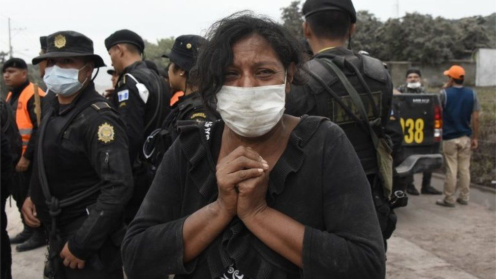 A woman cries for her missing relatives during the search for victims in San Miguel Los Lotes, a village in Escuintla Department, about 35 km southwest of Guatemala City, on June 4, 2018