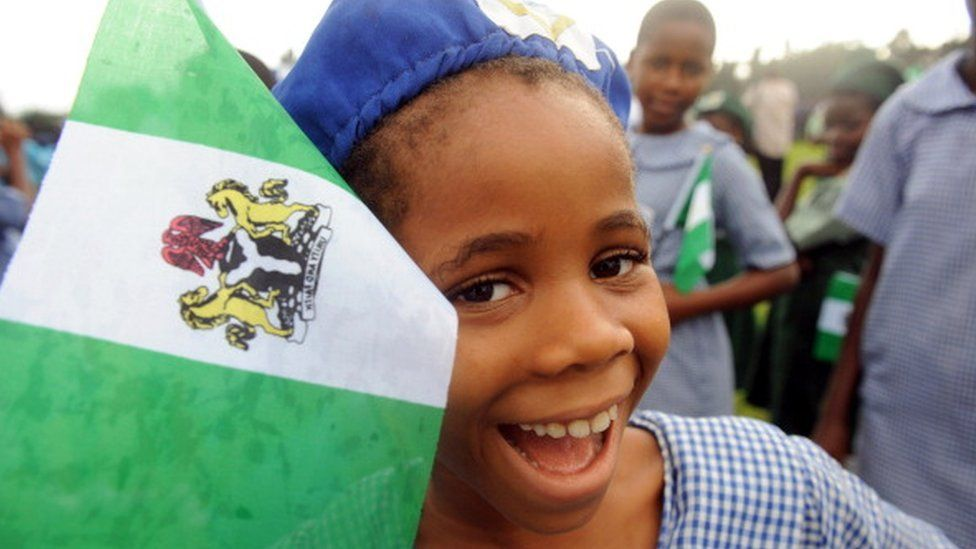 A Nigerian student smiles as she attends independence day celebrations in Lagos in October 1, 2013