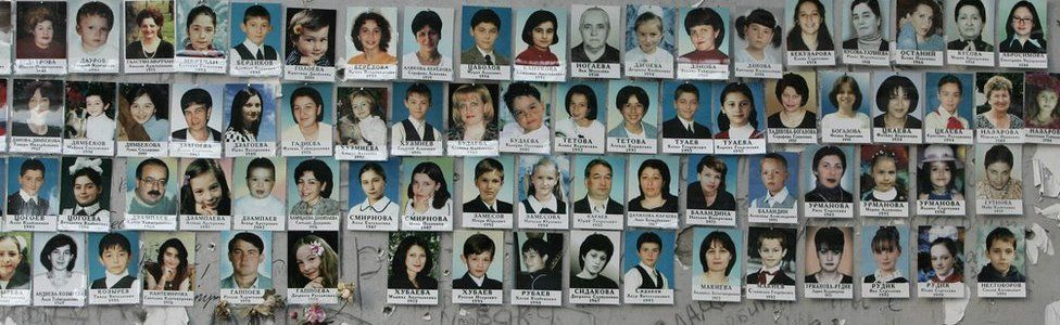 A picture made on 31 August 2005 shows portraits on the wall of school #1 of some of the victims of the Beslan crisis that erupted on 1 September, 2004