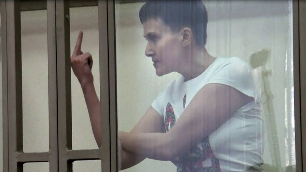 A screen grab taken from an AFP TV video on March 9, 2016 shows Ukrainian military pilot Nadiya Savchenko, accused of involvement in the killing of two Russian journalists in war-torn Ukraine, showing her middle finger