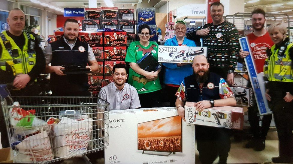 Tesco staff and police officers with gifts