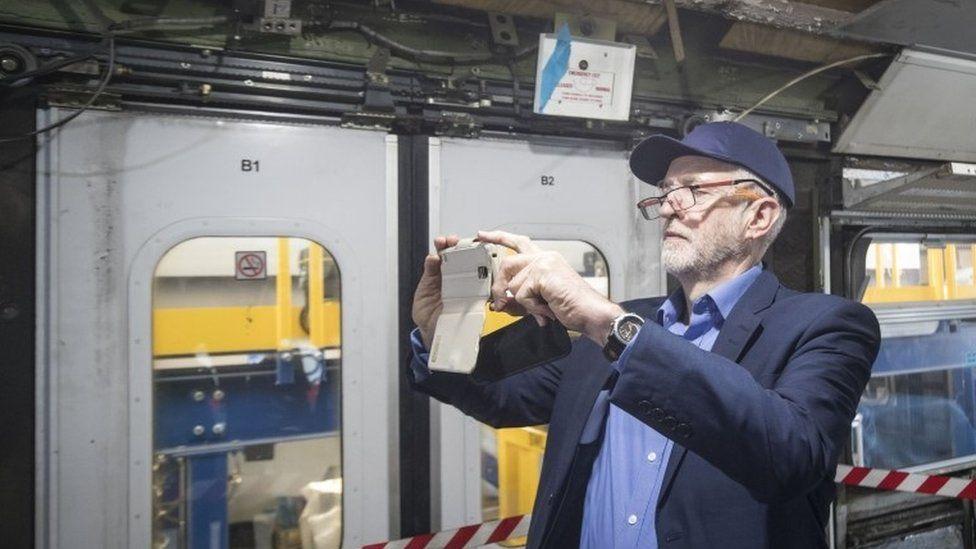 Jeremy Corbyn taking a photograph