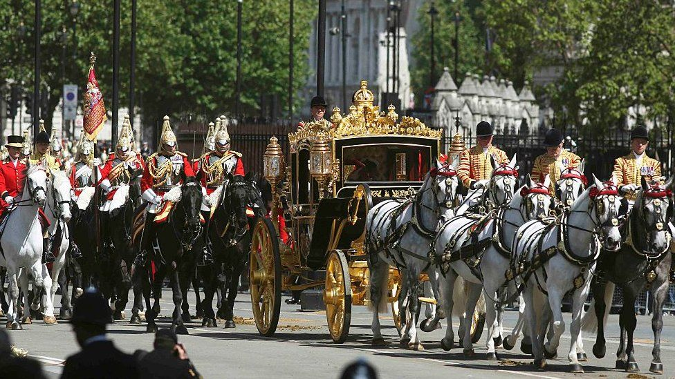 The Queen being driven by carriage during the State Opening of Parliament