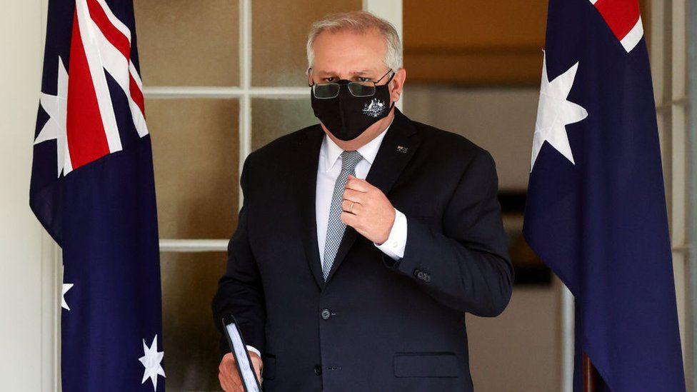 Australian Prime Minister Scott Morrison arrives for a media conference