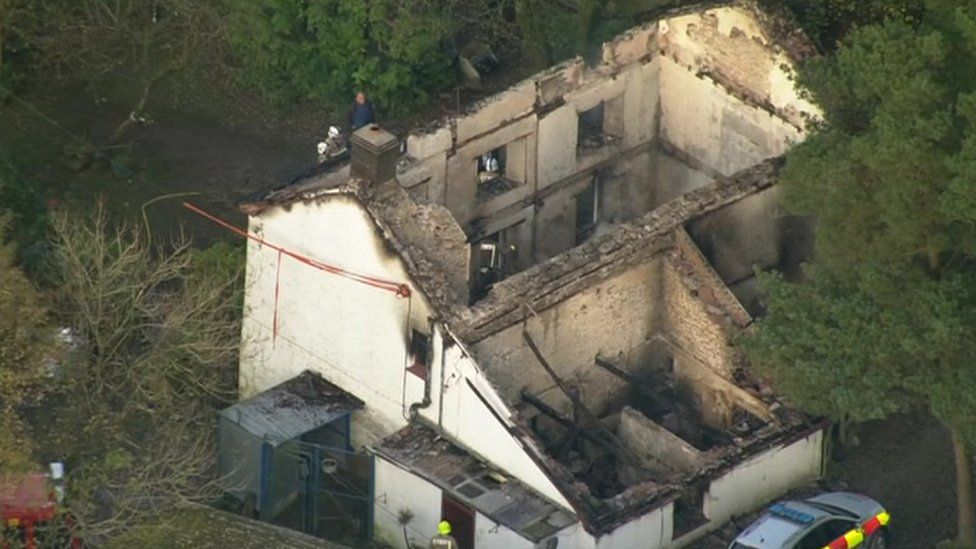 an aerial view of the house shows the devastation caused by the fire