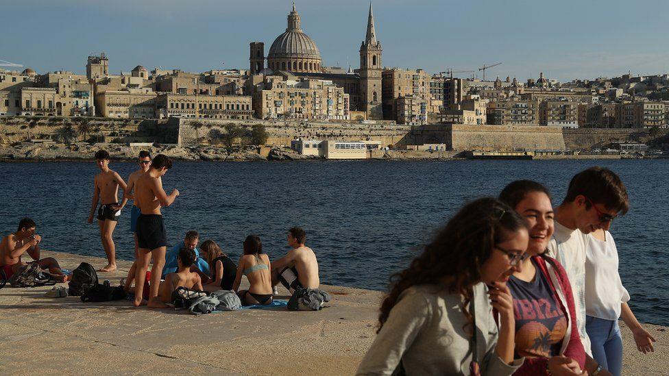 People relaxing on Valletta waterfront, Malta, 29 Mar 17