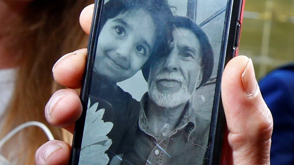 Daoub Nabi and his grandchild pictured on a mobile phone