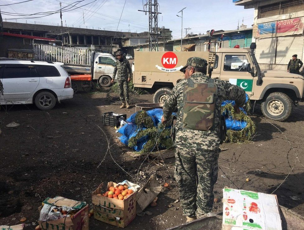 Pakistani security officials inspect the site of a bomb explosion at a vegetable market in Parachinar city, the capital of Kurram tribal district on the Afghan border on January 21, 2017.