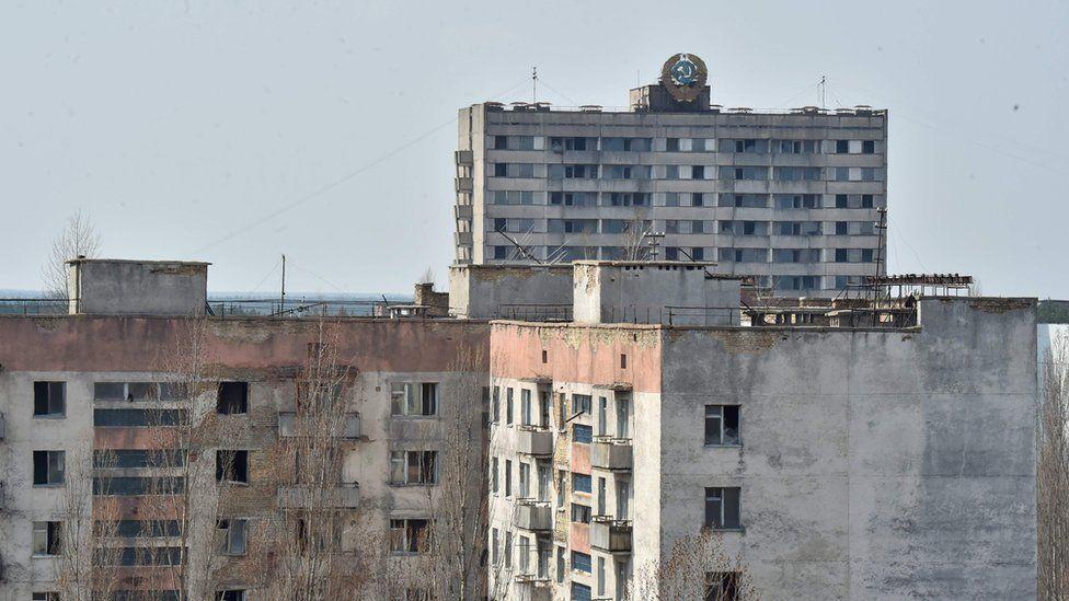 Soviet Union state emblem is set on a building of the ghost city of Pripyat near Chernobyl
