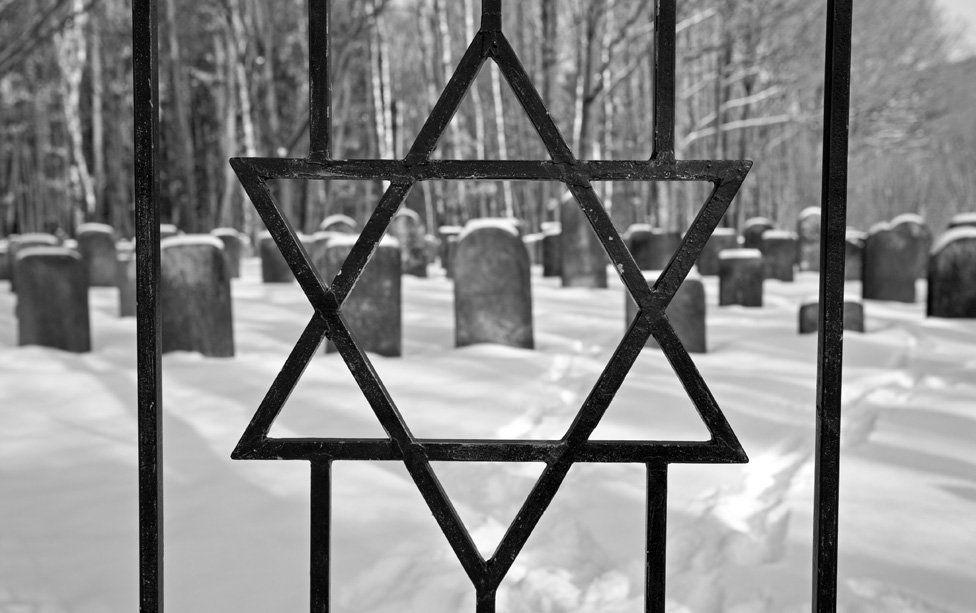 Star of David in railings of Jewish cemetery