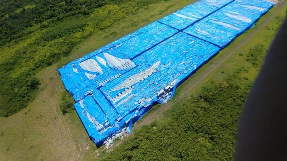 20,000 pallets of bottled water on the runway in Ceiba, Puerto Rico