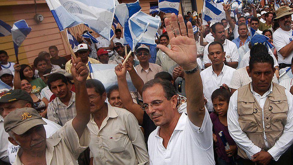 Opposition leader Eduardo Montealegre heads a protest against the Ortega government