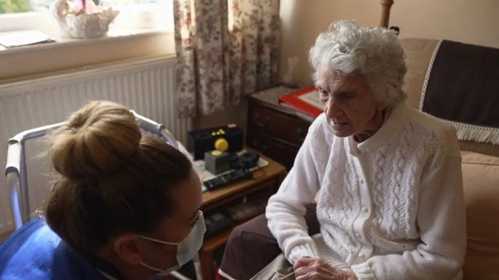 Care worker supporting 103 year old Margaret to live in her own home