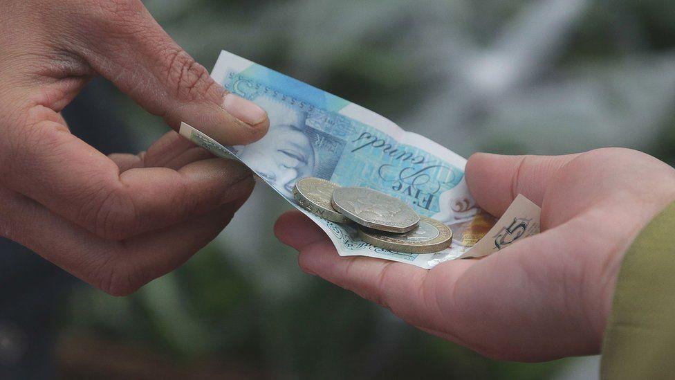 People exchanging money