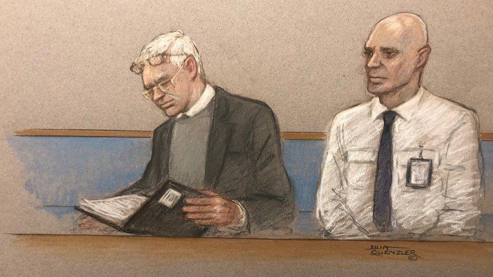 Julian Assange (left) at Woolwich Crown Court