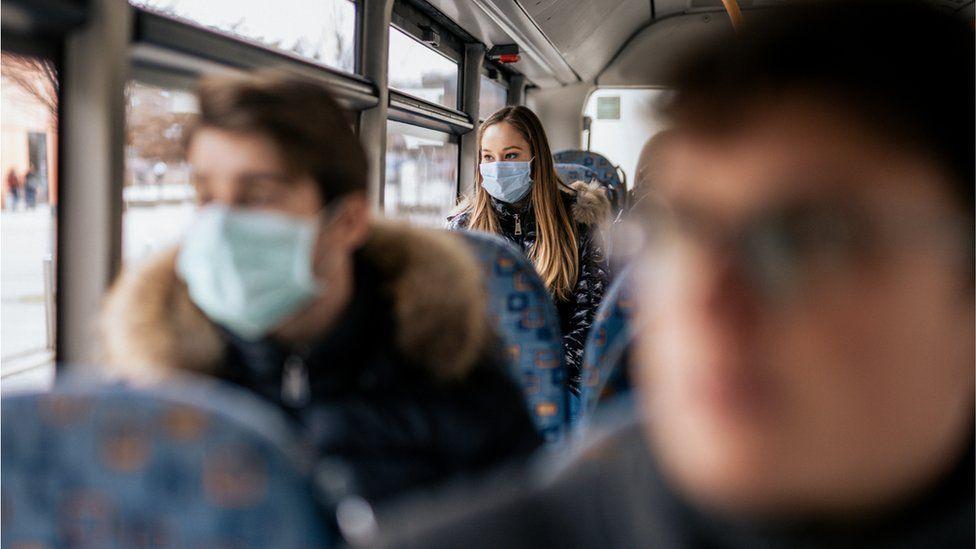 passengers wearing masks on a bus