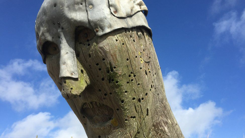 Close up of the Viking's face with pellet holes