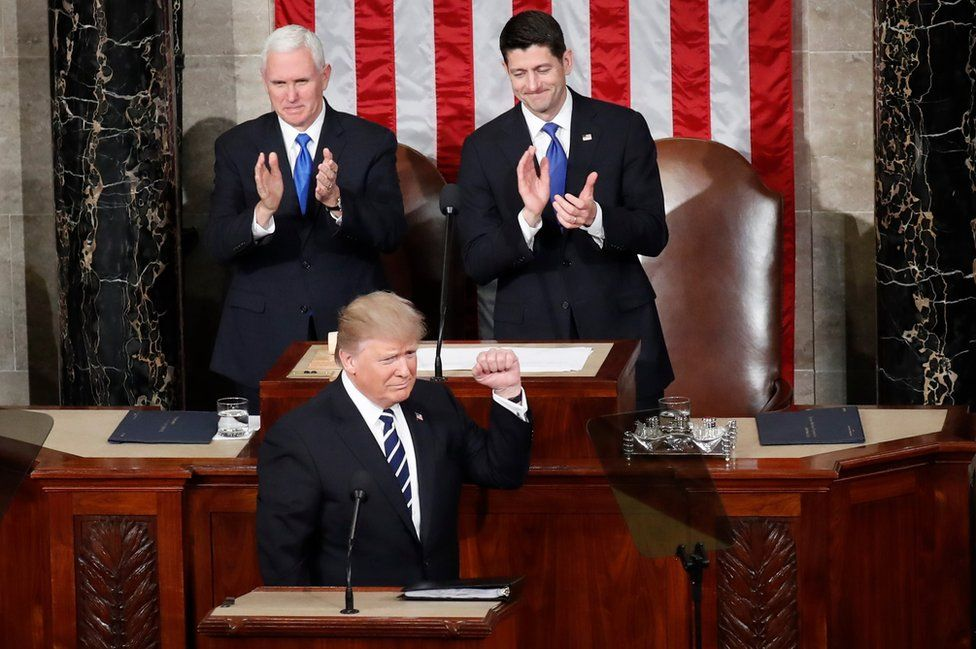 President Donald Trump, flanked by Vice-President Mike Pence and House Speaker Paul Ryan
