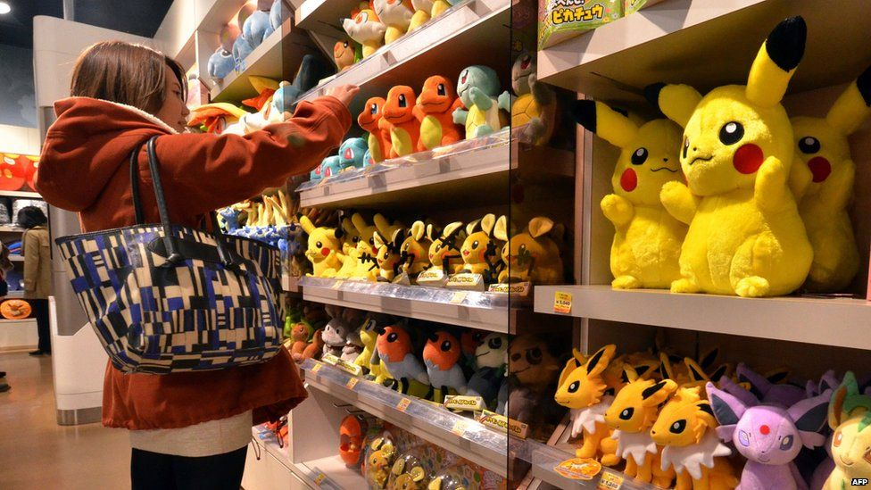 A customer looks at stuffed Pokemon dolls, a media franchise published and owned by Japanese videogame manufacturer Nintendo, at a Pokemon shop in Tokyo on January 29, 2014.