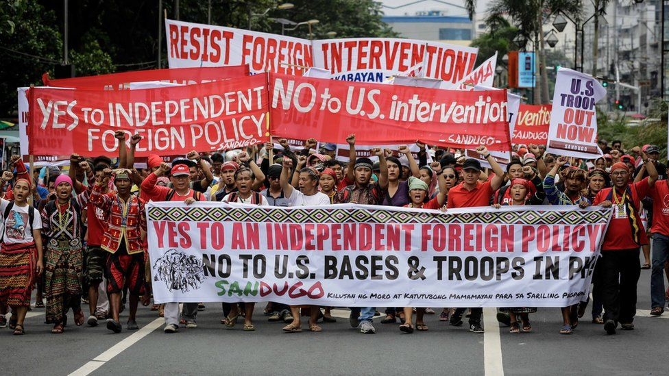 Filipino protesters march towards the US Embassy in Manila, Philippines, 19 October 2016