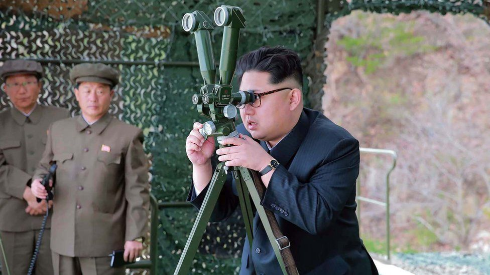 This picture released from North Korea's official Korean Central News Agency (KCNA) on 24 April 2016 shows North Korean leader Kim Jong-Un (R) inspecting an underwater test-fire of a strategic submarine ballistic missile at an undisclosed location in North Korea on 23 April 2016.
