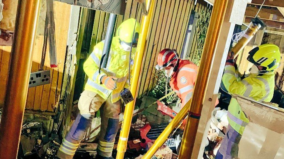 Firefighters make the kitchen safe after crash in Northfield