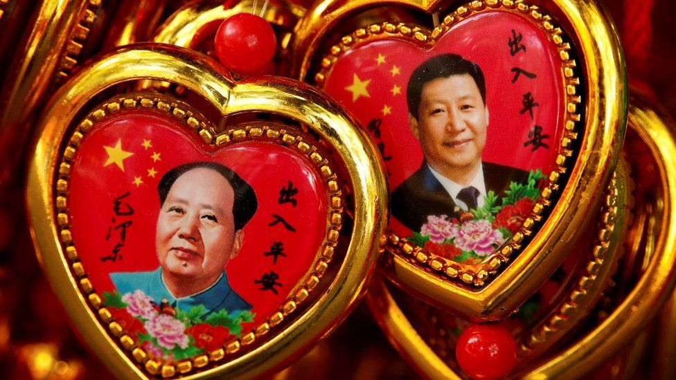 Souvenirs featuring portraits of China's late Chairman Mao Zedong and China's President Xi Jinping are seen at a shop near the Forbidden City in Beijing, China 9 September 2016