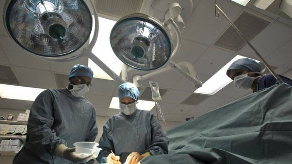 Surgeons in a theatre