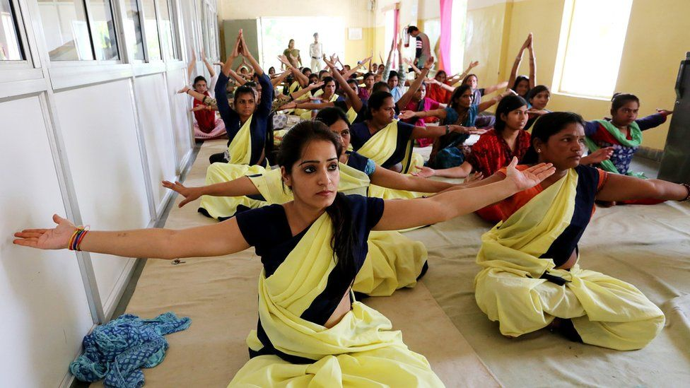 Inmates of Central Jail take part in a mass Yoga session on the occasion of International Yoga Day in Bhopal, India, 21 June 2017.