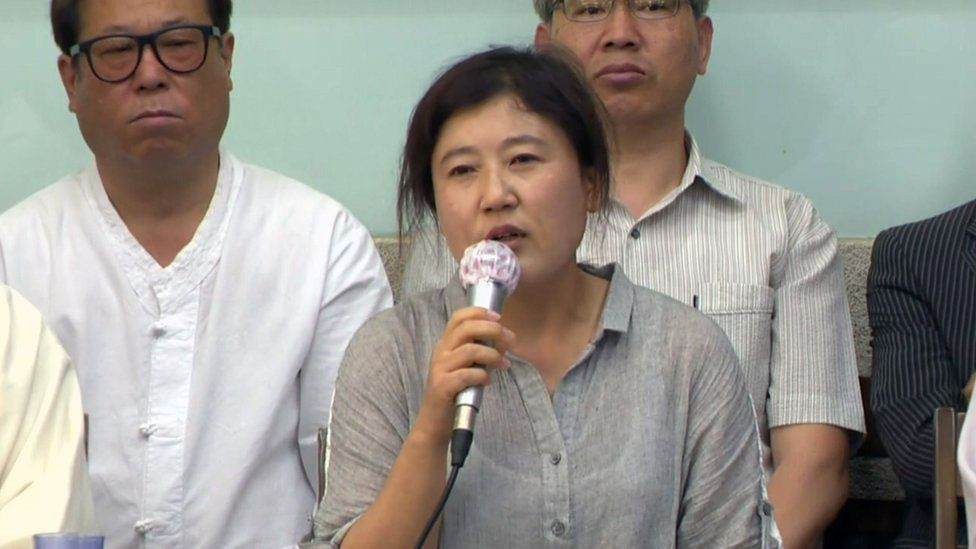 Kim Ryen-hi at the press conference where she announced she wanted to return to North Korea