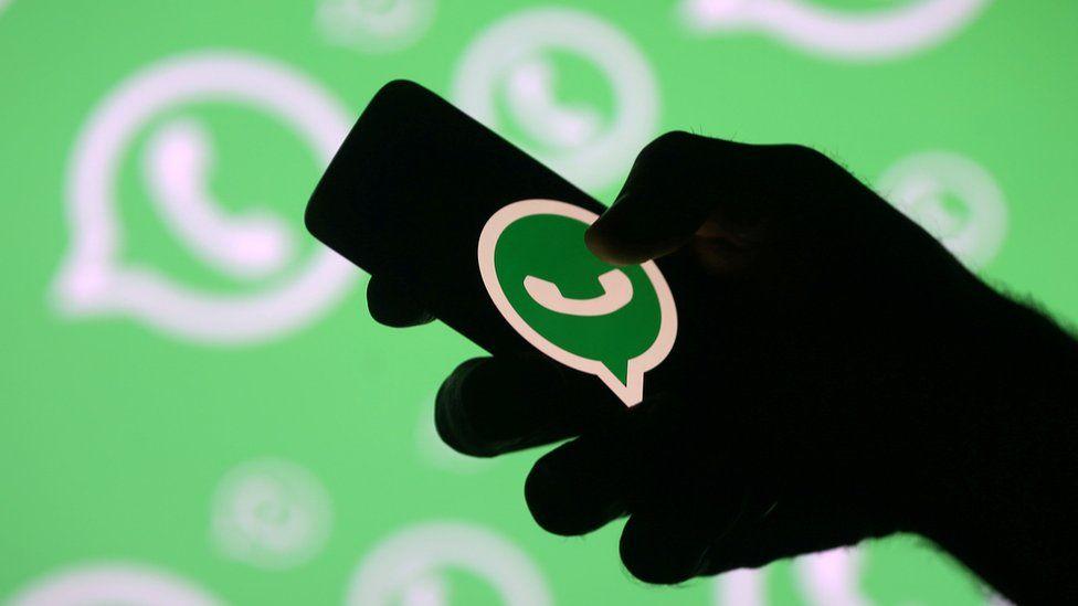 WhatsApp logo on a phone