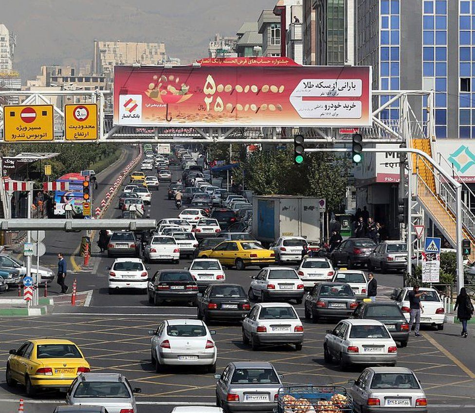 Cars on a street in the northwest of the capital Tehran