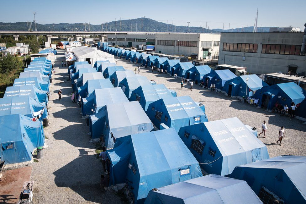 A row of blue tents photographed from above.