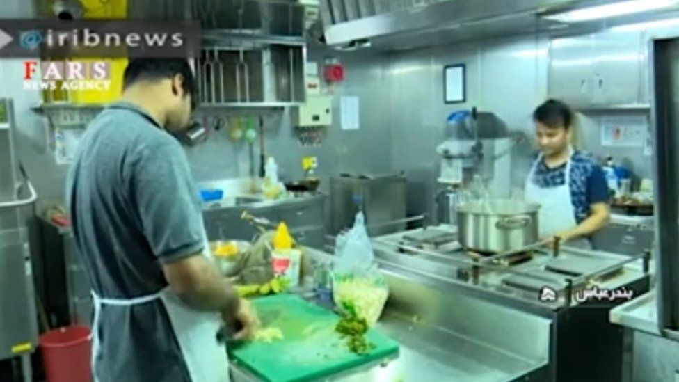 Cooks in the kitchen of the Stena Impero