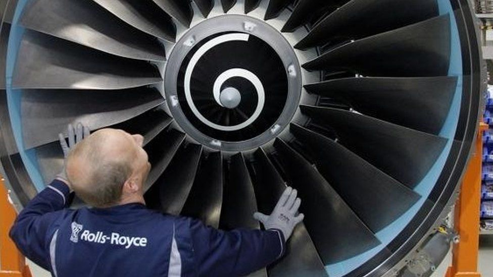 Rolls-Royce worker and jet engine