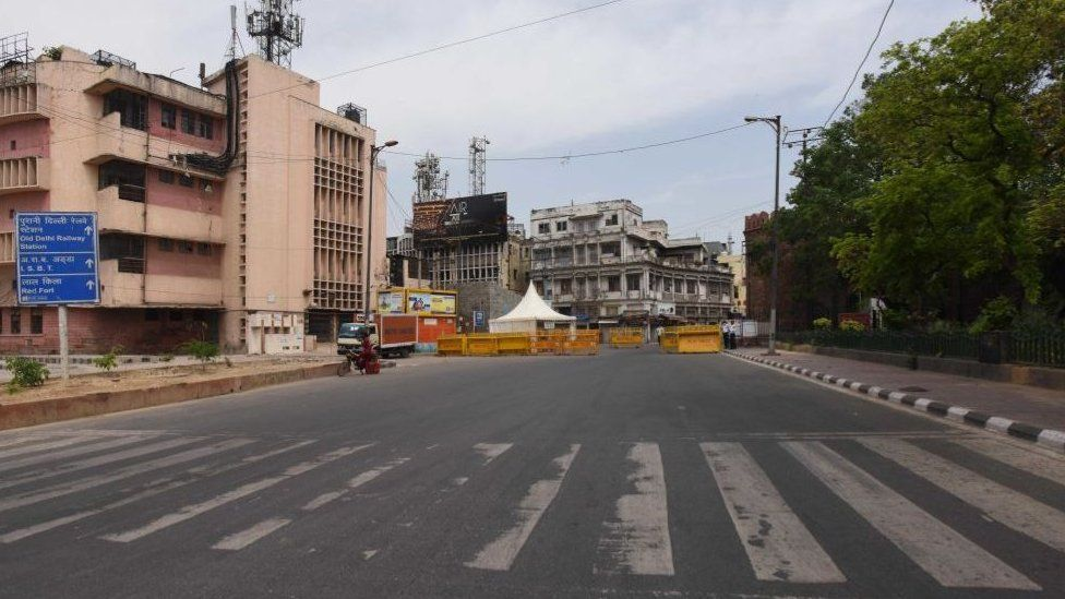 An empty stretch of the road and Delhi Police barricades to screen commuters during lockdown, at Delhi Gate on April 16, 2020 in New Delhi, India.
