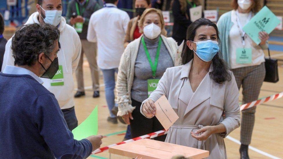 Rocio Monasterio (R) casts her vote during the Madrid election